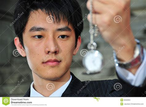 dare greatly commercial with asian guy asian man with pocket watch 3 stock images image 6550364