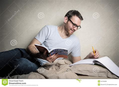 studying in bed studying in bed stock photo image 54755906
