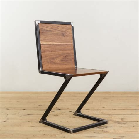 steel armchair walnut and raw steel z chair factor fabrication