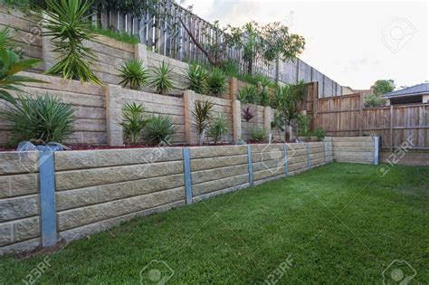how to level your backyard landscape multi level retaing wall with plants in backyard stock