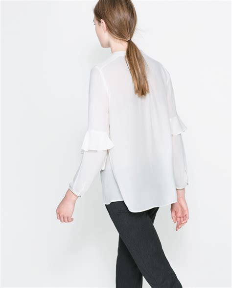 zara ruffle blouse zara blouse with ruffle sleeves in white lyst