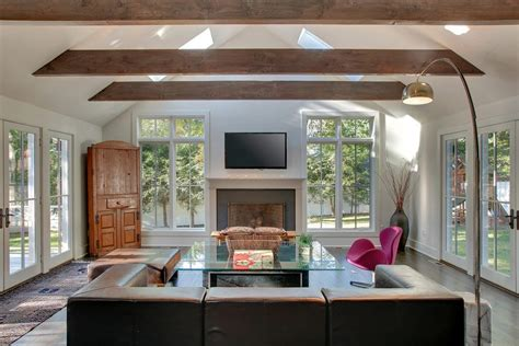 Vaulted ceiling beams living room contemporary with corner hutch brown leather sofa lots of windows