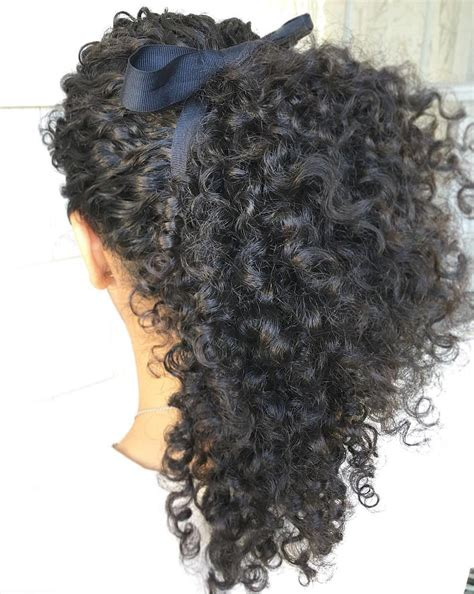 30 eye catching ways to style curly and wavy ponytails 30 eye catching ways to style curly and wavy ponytails