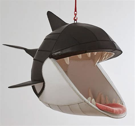 hanging animal chairs let you sit in the mouths of predators