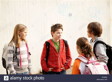 soap two girls and one boy two boys and two talking in the schoolyard stock photo 32139874 alamy
