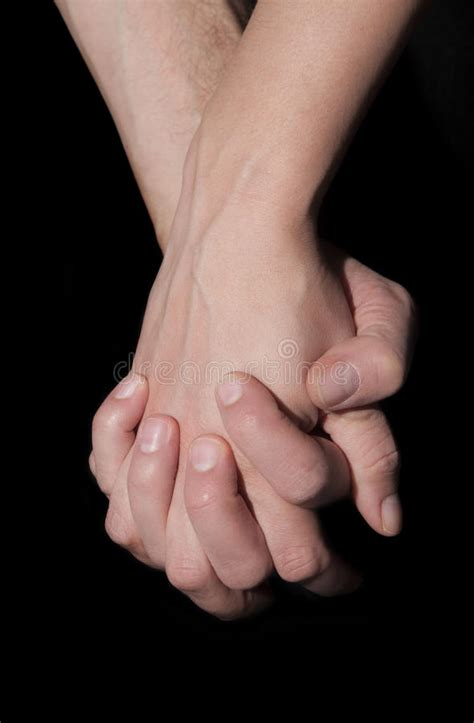 images of love hands together holding two hands together union and love concept stock