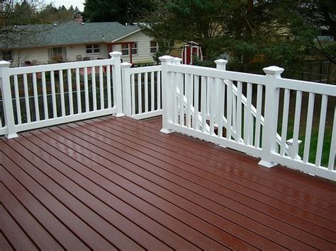 stained deck boards with painted railing deck backyard