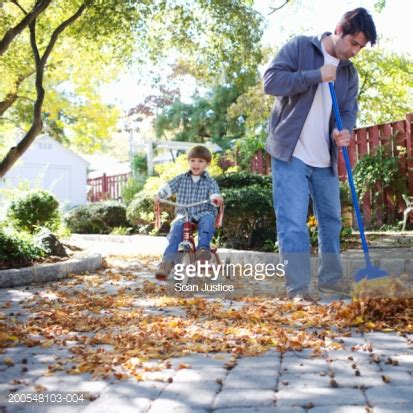 clean up backyard father cleaning backyard son cycling stock photo getty