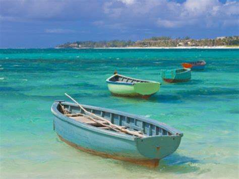 small boat in the ocean small fishing boats in the turquoise sea mauritius