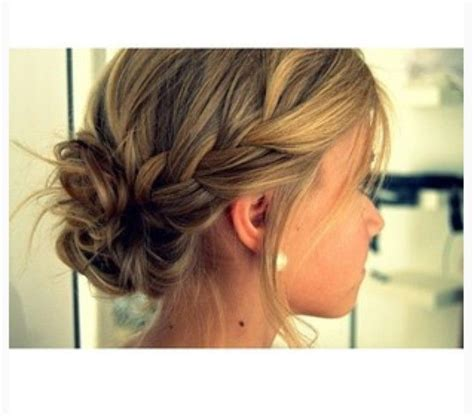 hair braided up into a bun style loose side braids pulled back into low loose bun brittany
