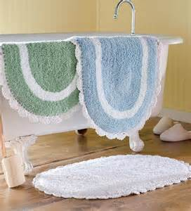 tufted chenille oval bath mat with crocheted trim