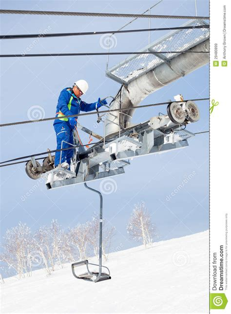Chair Lift Maintenance ski lift maintenance engineer editorial stock image
