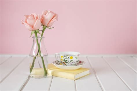 wooden background  vase coffee cup  book photo