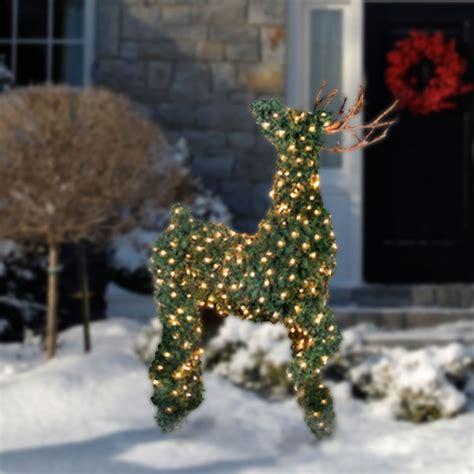 the illuminated topiary reindeer hammacher schlemmer