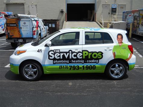 car service ad placement of pertinent information on a vehicle wrap