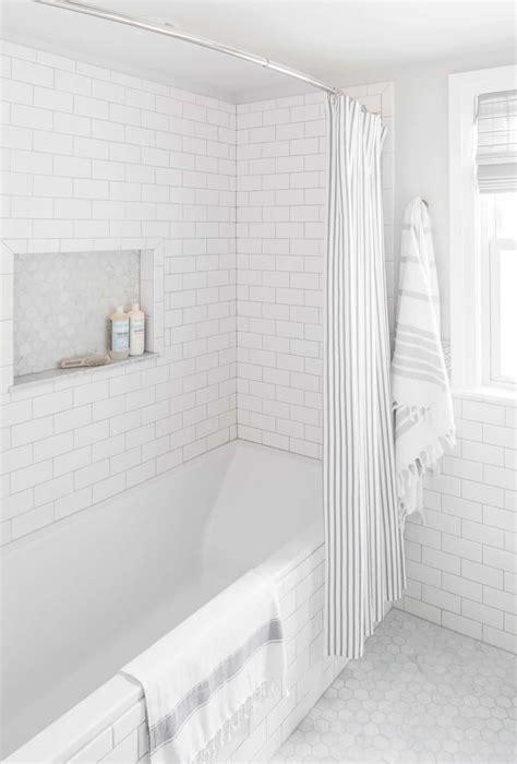 small bathroom renovation white subway tile centered