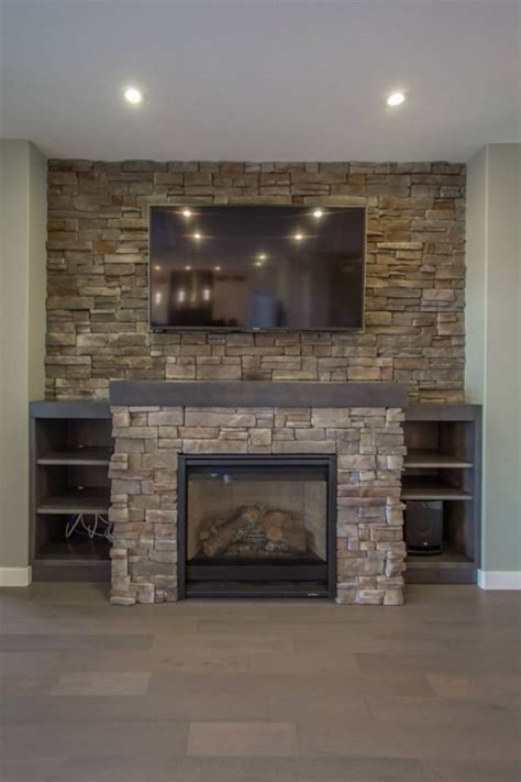 built out fireplace with accent around and