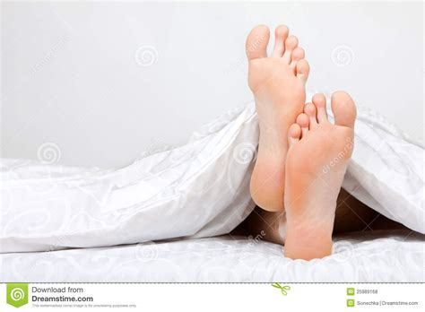 bed feet of two feet in a bed royalty free stock photos image