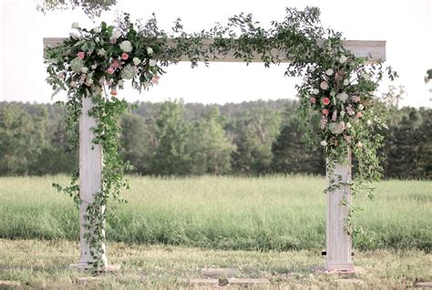 Wedding No Arch by White Wooden Wedding Arch With Greenery And Flowers
