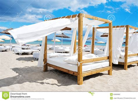 beach beds beds and sunloungers in a beach club in ibiza spain stock