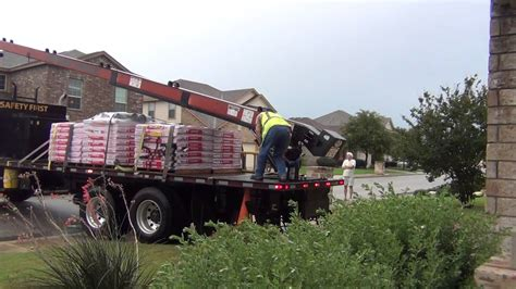 load shingles to roof loading new shingles onto the roof of a two story house