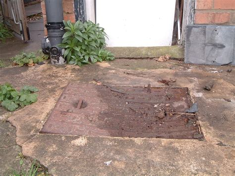 patio slabs and drain cover garden landscape