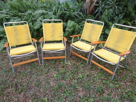 sunny yellow lawn chairs by telescope comfy metal patio
