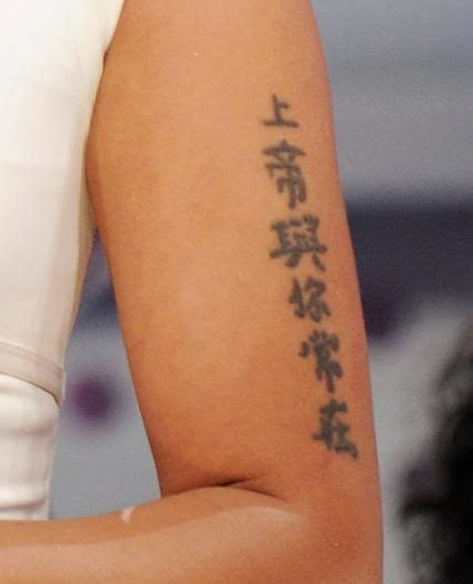 nicki minaj chinese tattoo nicki minaj s symbol translates to quot god is always