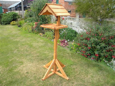wooden bird table with roof