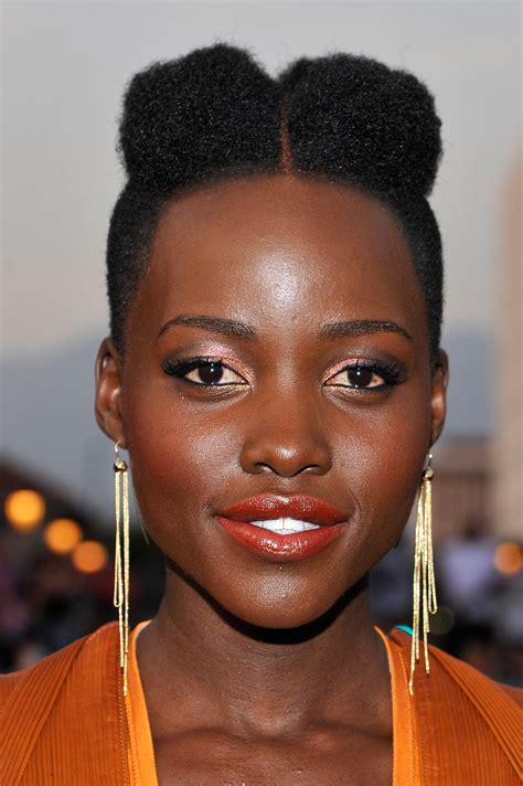hairstyles with afro puffs afro puffs popsugar beauty