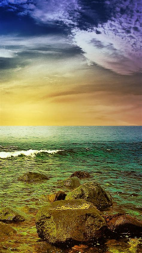 stormy sea rocks sunset android wallpaper