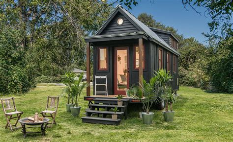 the new small house towable riverside tiny house packs every conventional