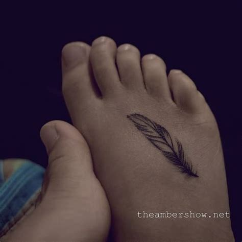 small tattoo on foot small feather on foot
