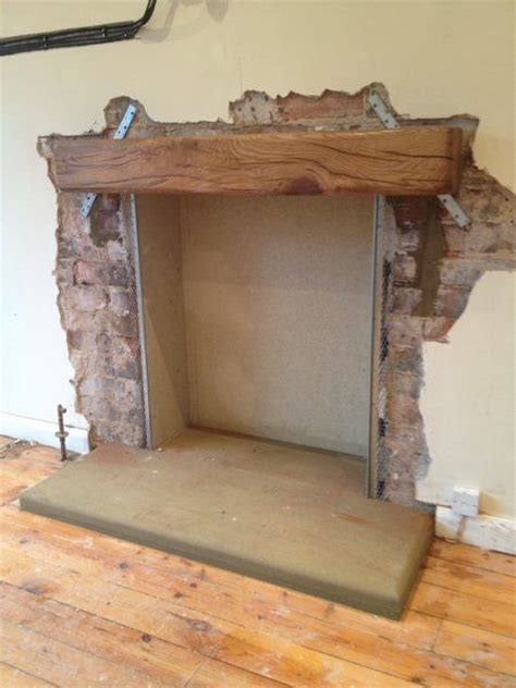 how to install a wood stove in a fireplace opening