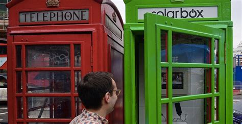 the green phone booth mindful phone booths converted into solar powered charging stations slashgear