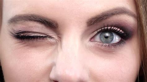 Eye Blink macro up eye blinking stock footage