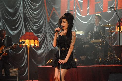 Winehouse Nabs A Brit Award by World News In Pictures Page 255