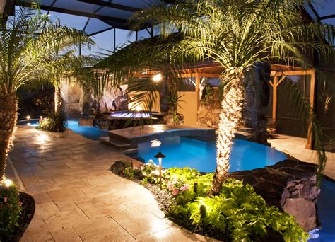 Pool And Outdoor Kitchen Designs Swimming Pool And Spa With Outdoor Kitchen Bar And Waterfalls Lucas Lagoons