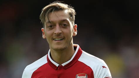 arsenal captain 2017 ozil is still a gunner and will play when fit so let s