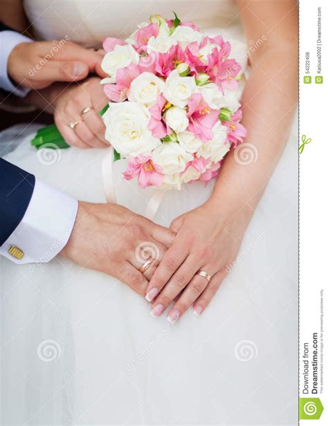 Wedding Holding by Wedding Holding With A Bouquet Of Flowers