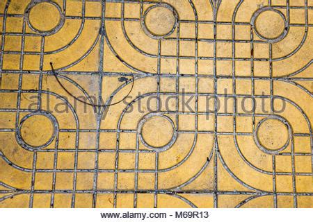 yellow patterned ground ground for street road sidewalk driveway pavers