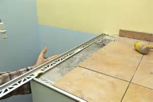 How To Frame A Bathroom Mirror With Molding Installing Tile Edging Howtospecialist How To Build