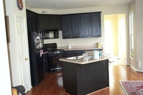 Kitchens With Black Cabinets Kitchen Kitchen Colors With Black Cabinets Pot Racks Muffin Cupcake Pans Table Linens Lids