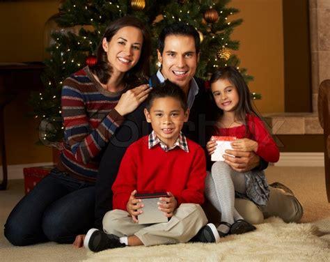 family christmas tree jarrettsville family in front of tree stock photo colourbox