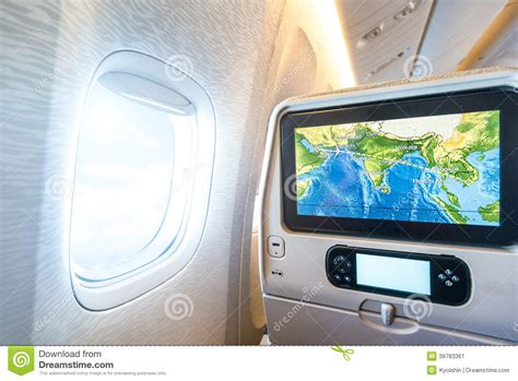 window seat instrumental seat monitor near window in passenger plane stock photo