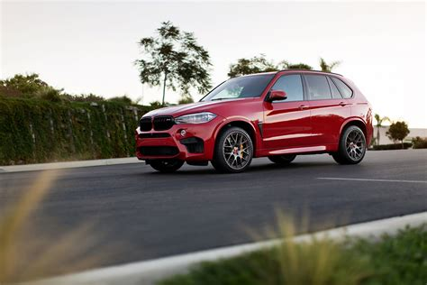 bmw red melbourne red bmw x5 m with aftermarket parts and wheels