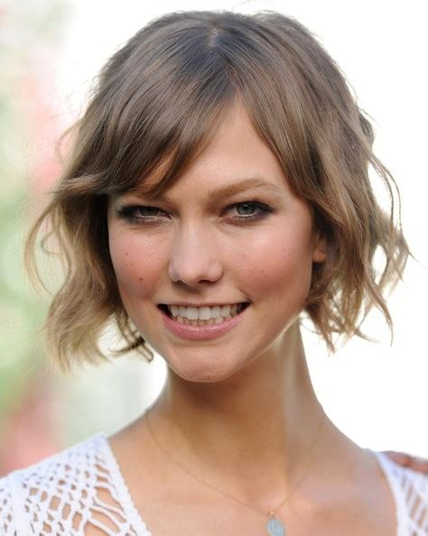 victoria secret model with short hair on the side and the back but long hair on the top more pics of karlie kloss short wavy cut 2 of 24 short