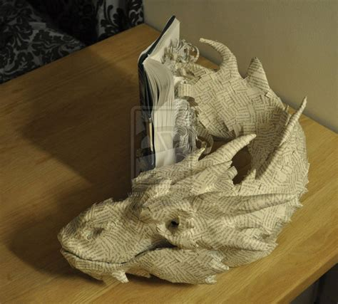 book sculpture smaug emerging from book sculpture smaug emerging from the hobbit geekologie