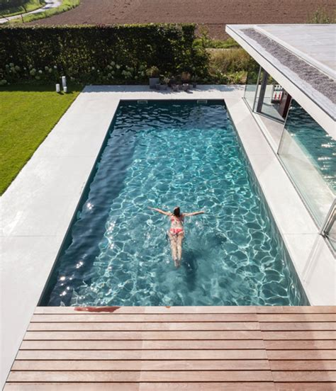 glass and concrete house glass concrete pool house by lieven dejaeghere daily icon