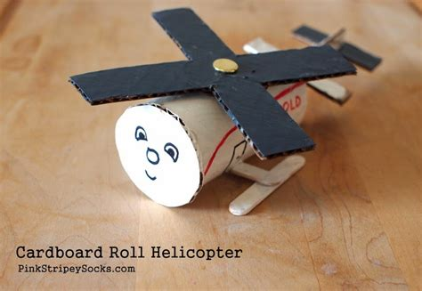 Make Paper Helicopter - toilet roll helicopter craft pink stripey socks